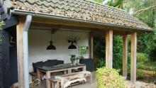 Een buitenhuis in eigen tuin