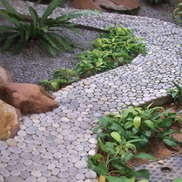 Welke materialen kun je gebruiken voor paden en terrassen?