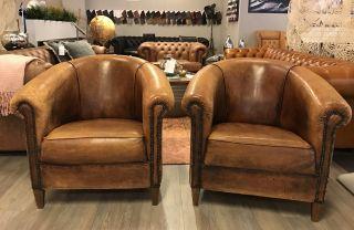 2 x Vintage schapenleren club fauteuils