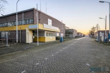 het industrie- casu quo bedrijventerrein gelegen aan de Rijksweg Noord (voor zover bekend ongenummerd), Nusterweg (onder andere genummerd 66 en ongenummerd) en dr. Philipsstraat (onder andere genummerd 4, 4A en ongenummerd)  Sittard